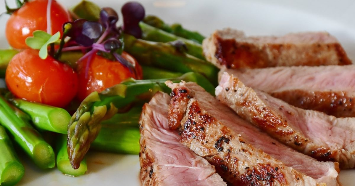 Grilled pork chops with asparagus and apple salsa